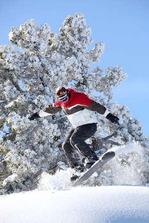 Man performing jump on snowboard photo