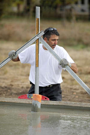 Man preparing building foundations photo