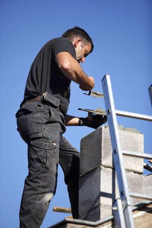 cement chimney: Roofer making a chimney stack
