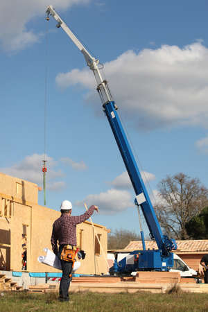 directing: Construction worker on site with a crane
