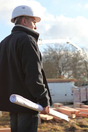 house coats: Architect overlooking work