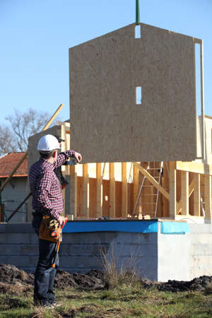 Foreman directing crane Stock Photo - 14212792