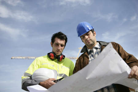 residential construction: Foreman and colleague at construction site Stock Photo