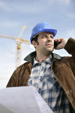 an erection: Foreman with a laptop and phone