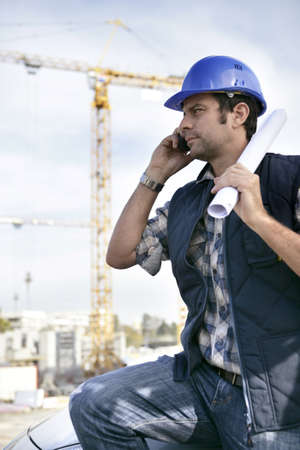 building worker: Foreman stood with site in the background Stock Photo