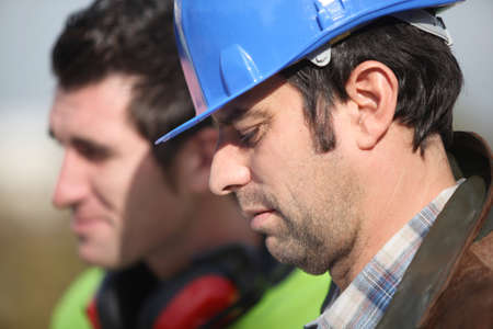 posted: Two construction worker at the site Stock Photo