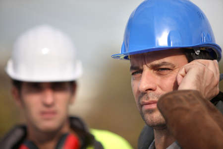 Foreman communicating via radio Stock Photo - 14212283