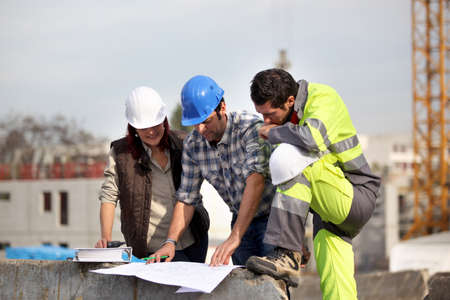 construction plans: Contruction supervisors prblem solving Stock Photo