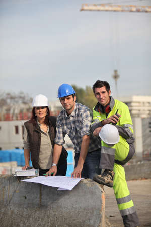 Three construction workers sharing their ideas photo