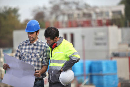 Two site workers sticking to the plans photo