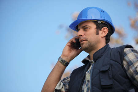 Foreman talking on his mobile phone photo