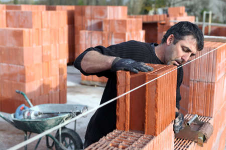 housing development: Worker building a wall Stock Photo
