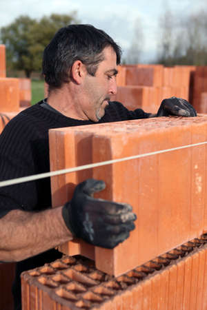 Builder laying bricks photo