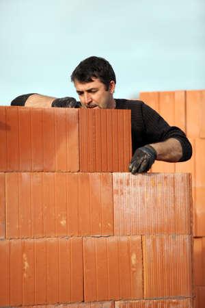 Man building a house photo