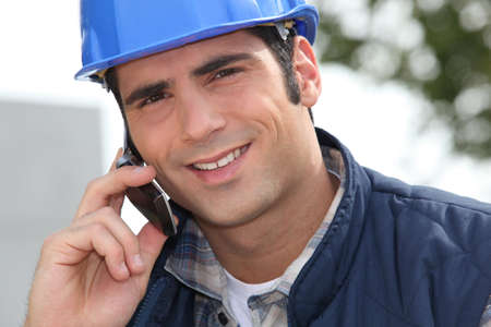 tradesmen: Foreman making a call Stock Photo