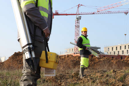architectural survey: surveyors on a construction site