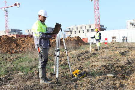 Surveyor on site with a laptop photo