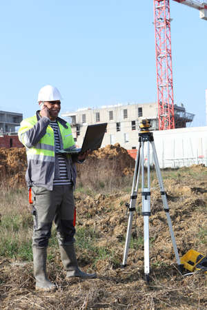 exact position: Surveyor on site with a laptop