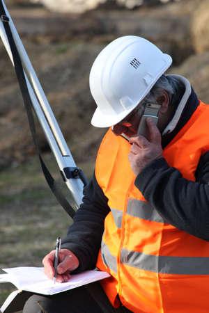 elevation meter: surveyor talking on the phone Stock Photo