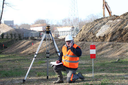 Surveyor setting up his specialized equipment photo