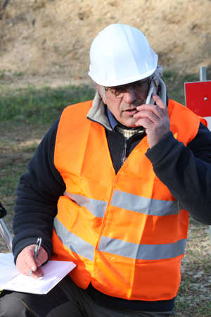 Tradesman talking on his mobile phone photo