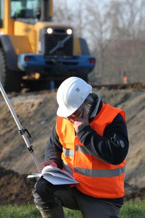 exact position: Surveyor working on construction site
