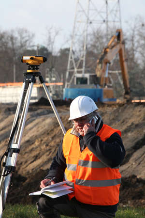 elevation meter: Surveyor at construction site