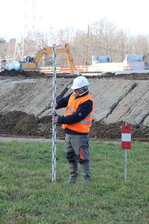 senior land surveyor photo