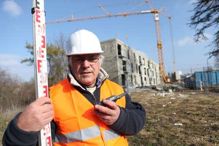elevation meter: surveyor on a construction site