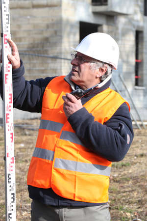Experienced construction site surveyor photo