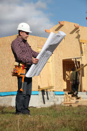 house inspection: Architect with plan Stock Photo
