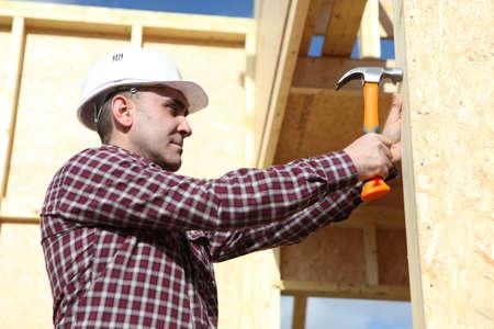 dexterity: carpenter with hammer Stock Photo