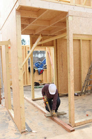 rafter: Builder working on a wooden structure