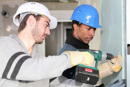 Man using a power tool photo