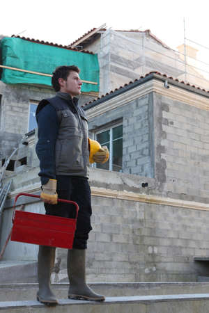 Man arriving at building site photo