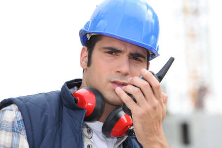 craftsman using a talkie-walkie Stock Photo - 14213979