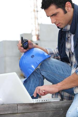 Foreman with radio and computer photo