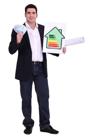 directive: Engineer holding money and an energy efficiency rating sign