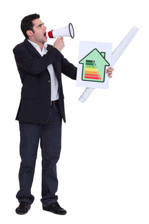 Businessman with a loudspeaker and energy rating card photo