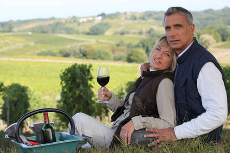vine country: Couple enjoying hill-side picnic Stock Photo