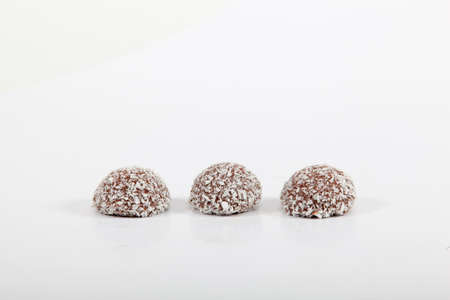 Coconut covered chocolate candy photo