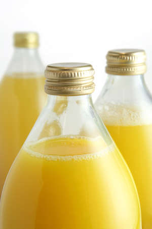Three glass bottles of fruit juice Stock Photo - 15118301