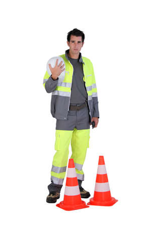 Traffic worker stood by cone Stock Photo - 15071908