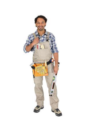 journeyman technician: Carpenter posing with spirit level