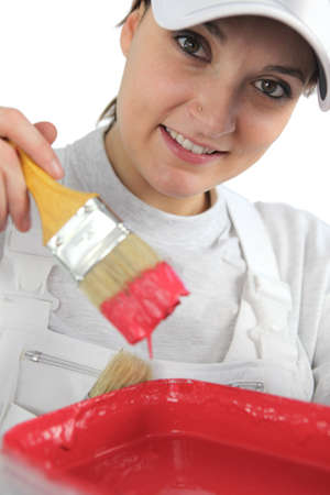 painter and decorator: Female decorator with red paint