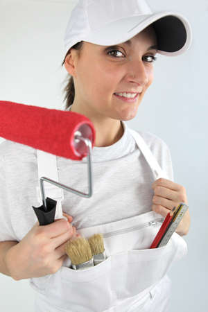 redecorating: Woman redecorating house