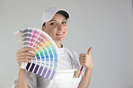 Smiling woman painter holding swatches photo