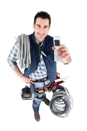 top angle: electrician with telephone and tools Stock Photo