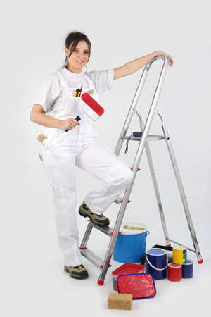 scaling ladder: Female decorator about to start painting