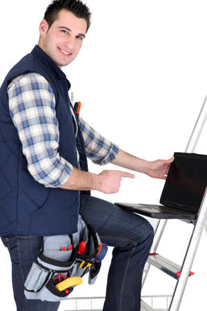 Handyman with laptop, studio shot Stock Photo - 15072615
